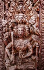 Old wooden door were carved Thai pattern