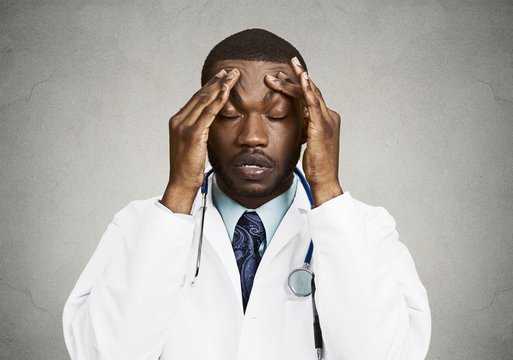 Stressed doctor, health care professional, grey wall background