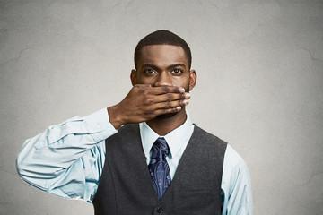 Man covers his mouth, speak no evil concept