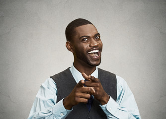 Happy businessman pointing fingers at you, laughing