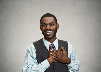 Happy, surprised young businessman, grey wall background