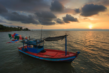 fishing boat in the sea sunset