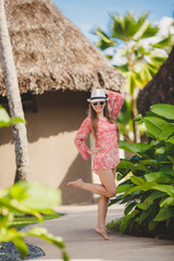 Brunette model poses in a tropical resort