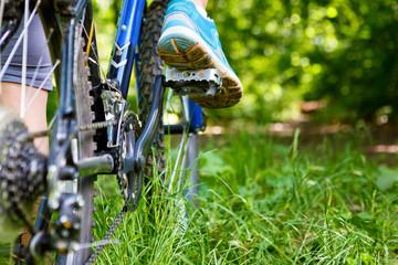 Closeup of woman riding mountain bike outdoors.