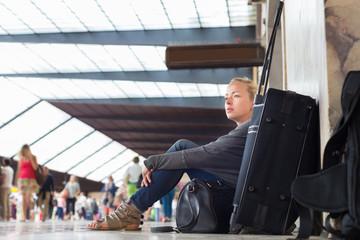 Female traveler waiting for departure.