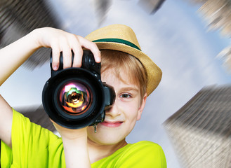 Young photographer with a camera, cityscape background