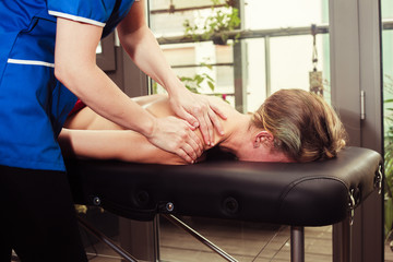 Woman being massaged on a table
