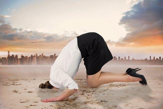 Composite image of businesswoman burying her head