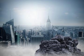 Large rock overlooking big city
