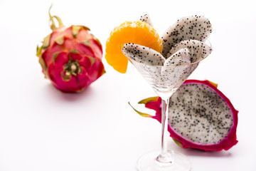 Fruit wedges of the dragon fruit in a glass