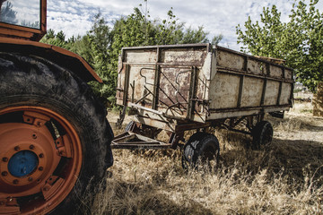 rural, old agricultural tractor abandoned in a farm field