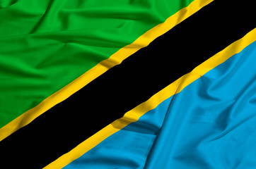 Tanzania flag on a silk drape waving