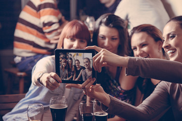 Young Cheerful Friends In Pub