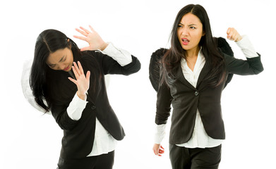 Asian young businesswoman dressed as black angel punching the