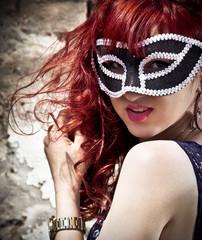 Beautiful girl in a carnival mask.