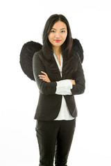 Asian young businesswoman dressed up as black angel standing