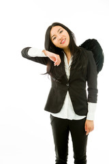 Asian young businesswoman dressed up as black angel pretending