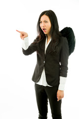 Angry Asian young businesswoman dressed up as black angel