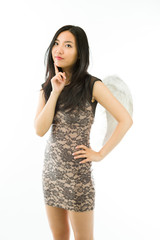 Asian young woman dressed up as an angel standing with her hand