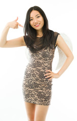 Asian young woman dressed up as an angel pointing herself