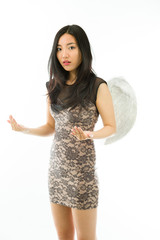 Asian young woman dressed up as an angel gesturing isolated on