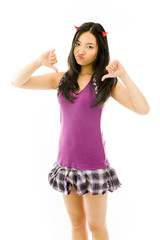 Asian young woman dressed up as a devil and showing thumbs down