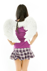 Rear view of a Asian young woman dressed up as an angel standing