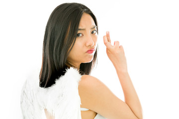 Angel side of a young Asian woman turning back and making her