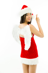 Side Profile of a Asian young woman wearing Santa costume