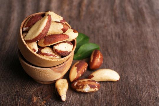 Tasty brasil nuts on wooden background