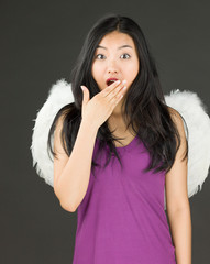 Angel side of a young Asian woman looking shocked
