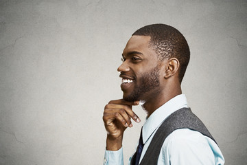 Side view headshot happy, smiling daydreaming businessman