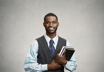 Portrait confident young man, student holding books