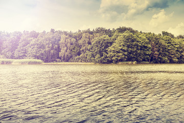 Peaceful nature vintage lake background.