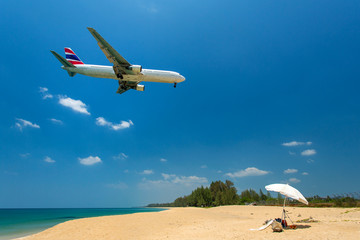 Airplane flying over the tropical island beach