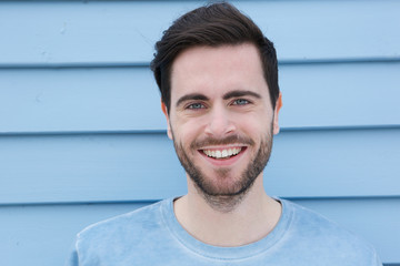 Fototapeta Handsome young man with beard smiling