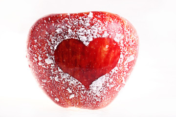 red apple with a heart on a white background