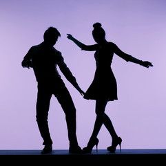 Male dancer flirting with sexy woman