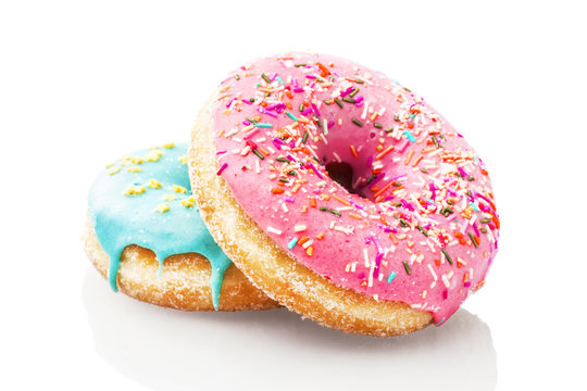 Two glazed donuts isolated on white background