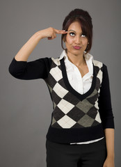 Indian businesswoman pointing finger to head