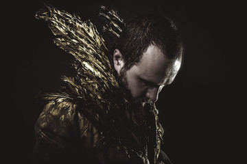 Wings, glamorous man suit made with golden feathers