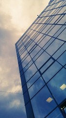 Modern office building glass wall and sky