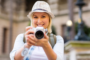 female tourist taking picture with digital camera