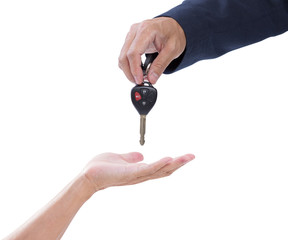 business man handing giving car remote keys to a casual senior m