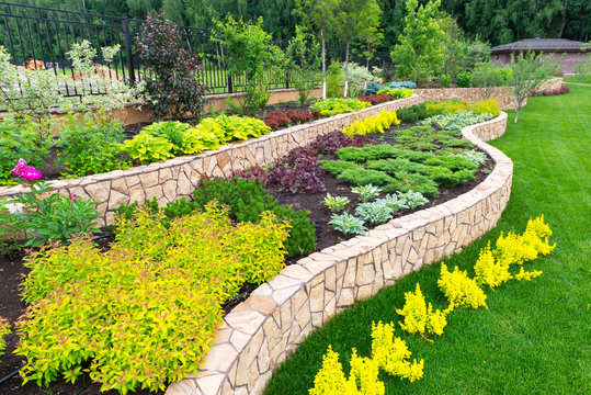 Landscape design in home garden. Landscaping, nature and house concept.