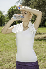 young attractive woman drinking water