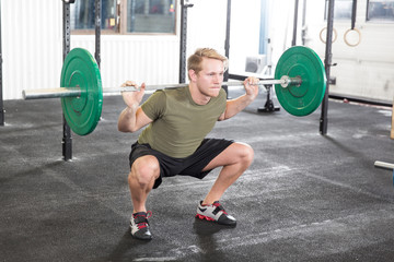 Squat workout at fitness gym center