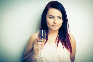 Pretty, young woman having glass of wine