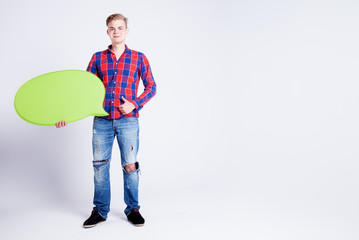 Handsome man holding empty board