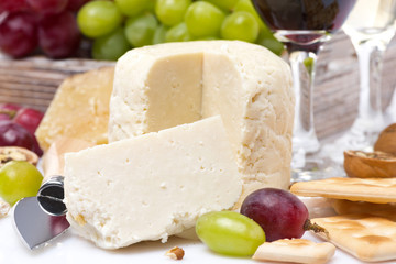 fresh cheese, crackers and grapes, close-up